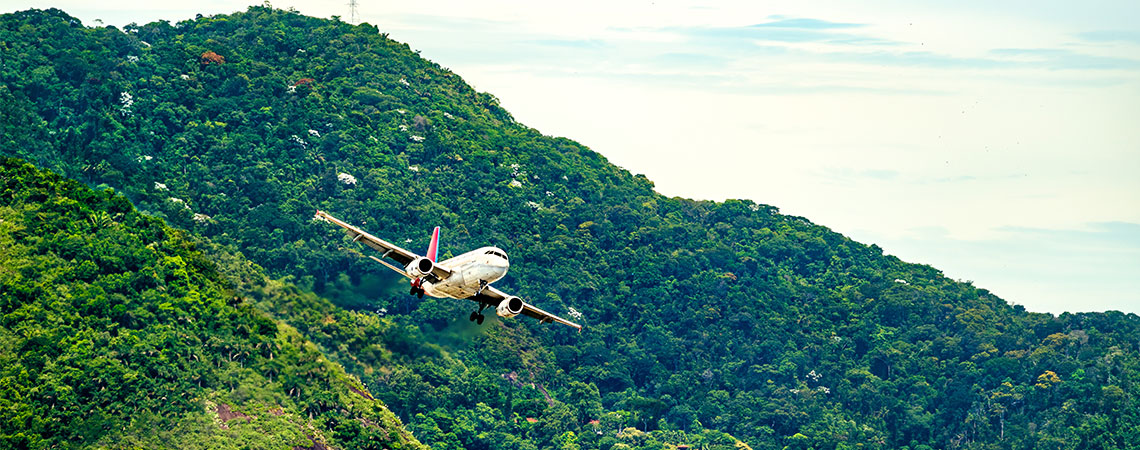Small plane flying close to hills in Uganda